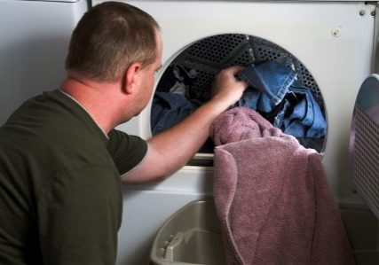 unloading clothes from dryer